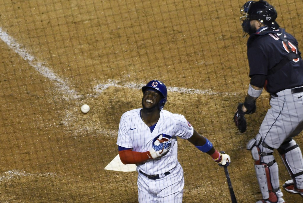 Chicago Cubs' Cameron Maybin reacts after being hit by a pitch with the bases loaded, scoring the winning run during the ninth inning of the team's ba...