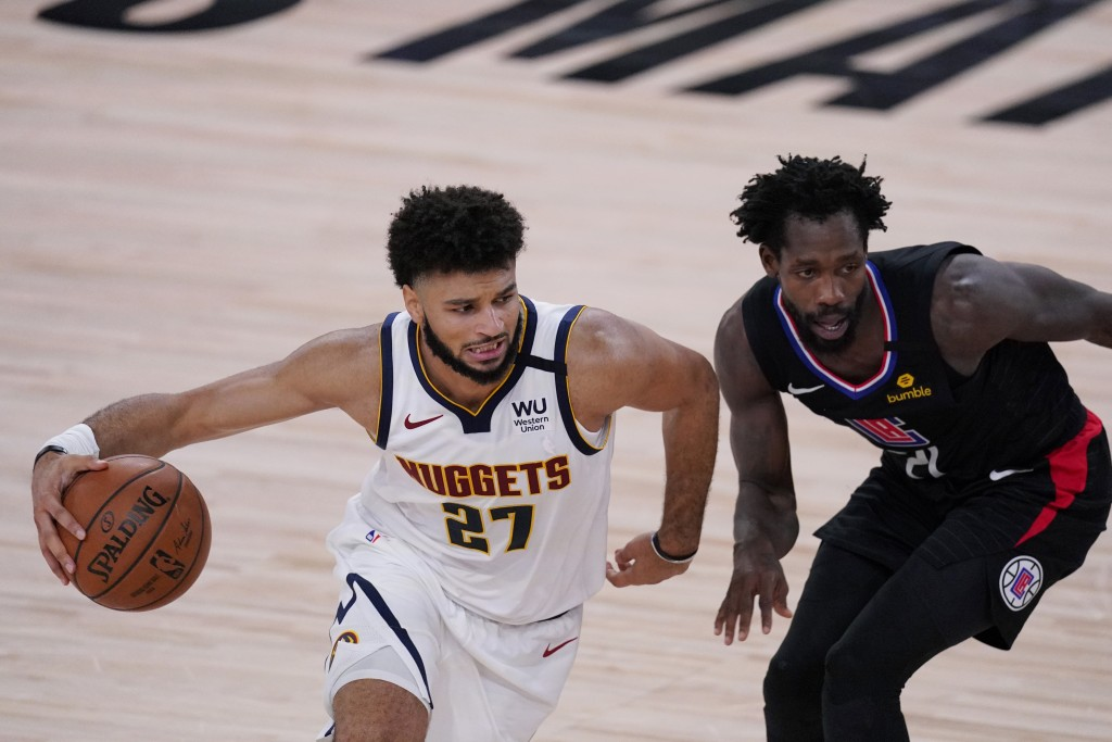 Denver Nuggets guard Jamal Murray (27) drives around LA Clippers guard Patrick Beverley (21) during the first half of an NBA conference semifinal play...
