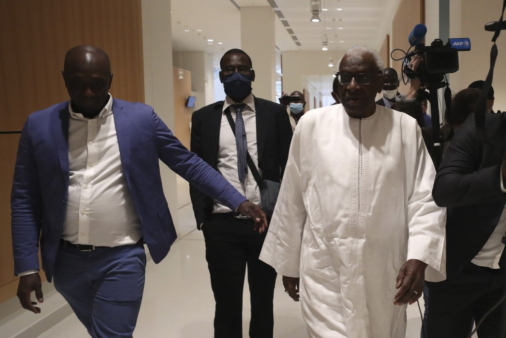 FILE - In this June 10, 2020 file photo, former president of the IAAF (International Association of Athletics Federations) Lamine Diack, right, arrive...