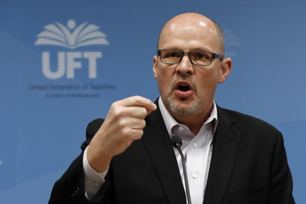 FILE- In this March 15, 2020 file photo, Michael Mulgrew, president of the United Federation of Teachers in New York City, addresses a news conference...