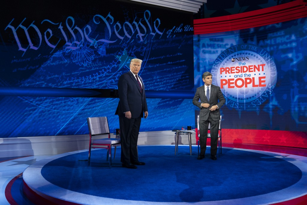 President Donald Trump and ABC News anchor George Stephanopoulos arrive to tape a town hall at National Constitution Center, Tuesday, Sept. 15, 2020, ...