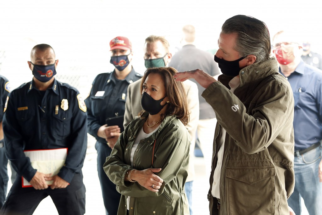 Calif. Gov. Gavin Newsom, right, and Democratic vice presidential candidate Sen. Kamala Harris, D-Calif., are briefed on the Creek Fire at Pine Ridge ...