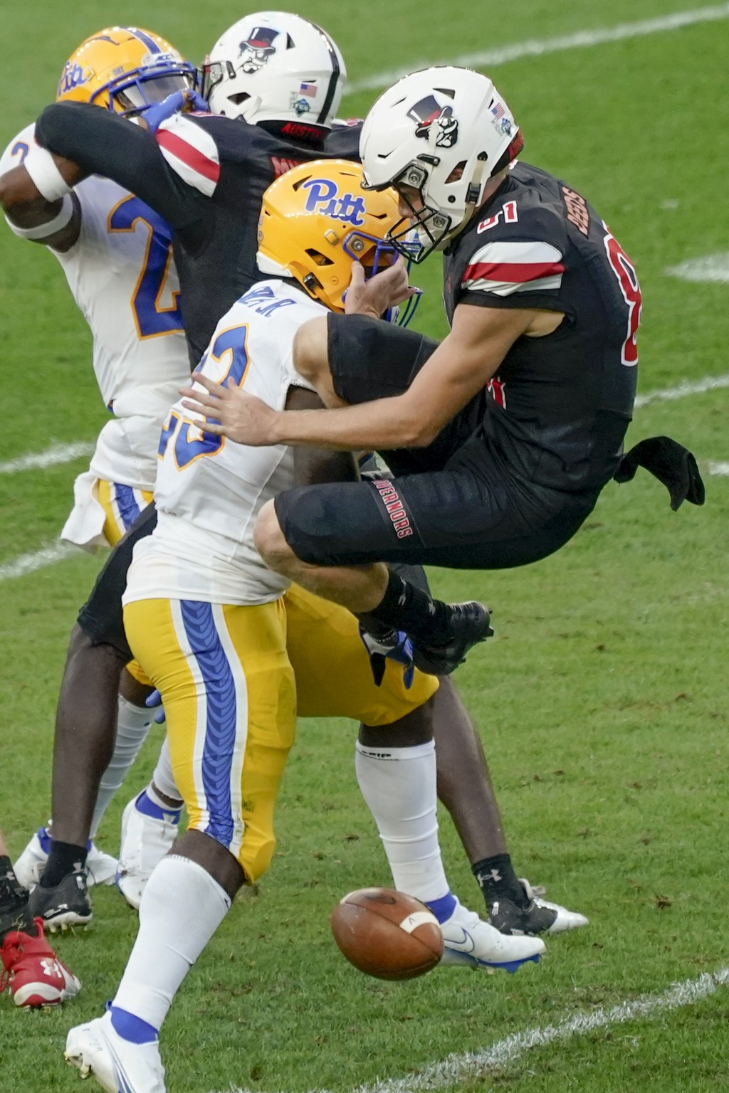 FILE - In this Saturday, Sept. 12, 2020, file photo, Pittsburgh's Todd Sibley Jr. (23) blocks a punt by Austin Peay punter Cole Deeds before returning...