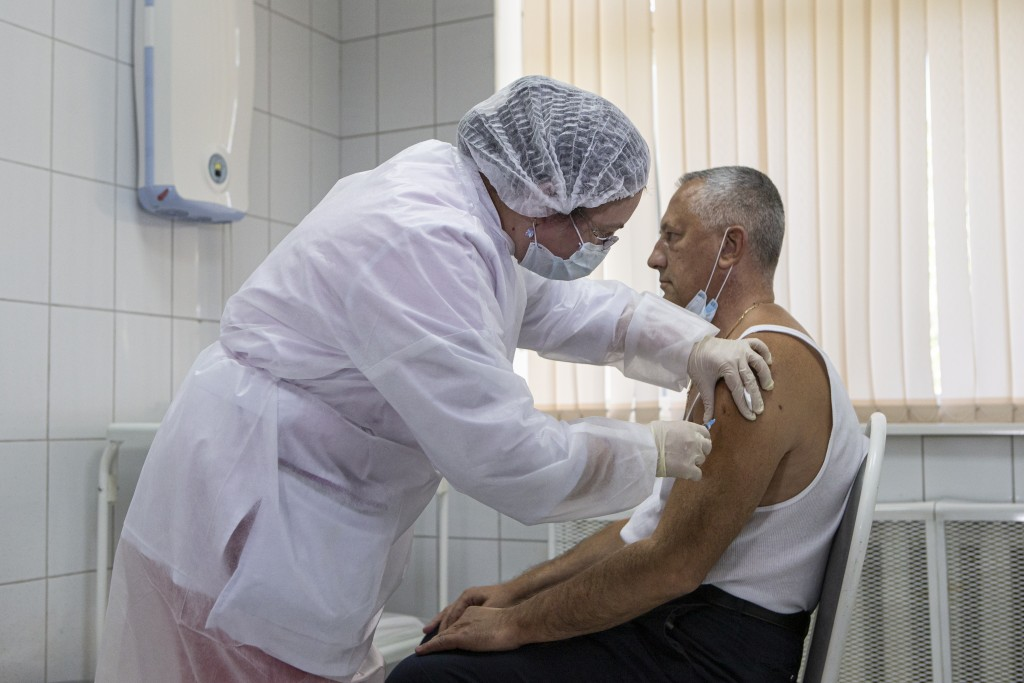 A Russian medical worker adminsters a shot of Russia's experimental Sputnik V coronavirus vaccine in Moscow, Russia, on Tuesday, Sept. 15, 2020. Russi...