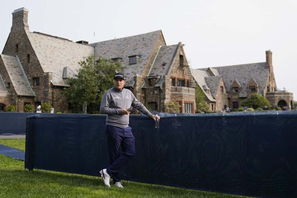 Sami Valimaki, of Finland, waits outside the clubhouse before practicing for the U.S. Open Championship golf tournament, Tuesday, Sept. 15, 2020, at t...