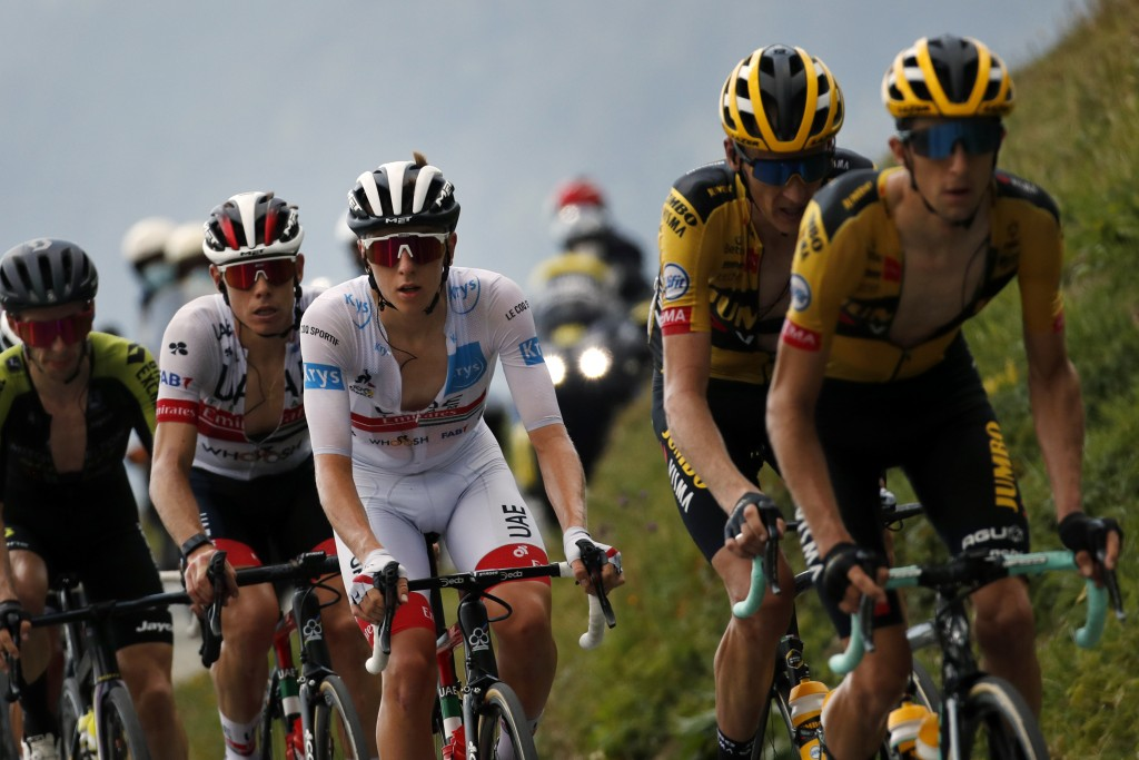 Slovenia's Tadej Pogacar, wearing the best young rider's white jersey, rides with the pack during the stage 17 of the Tour de France cycling race over...