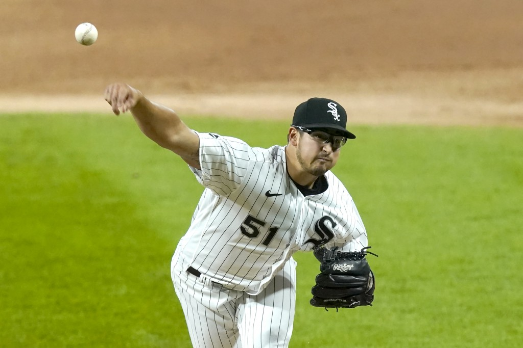 Chicago White Sox starting pitcher Dane Dunning delivers during the first inning of the team's baseball game against the Minnesota Twins on Tuesday, S...