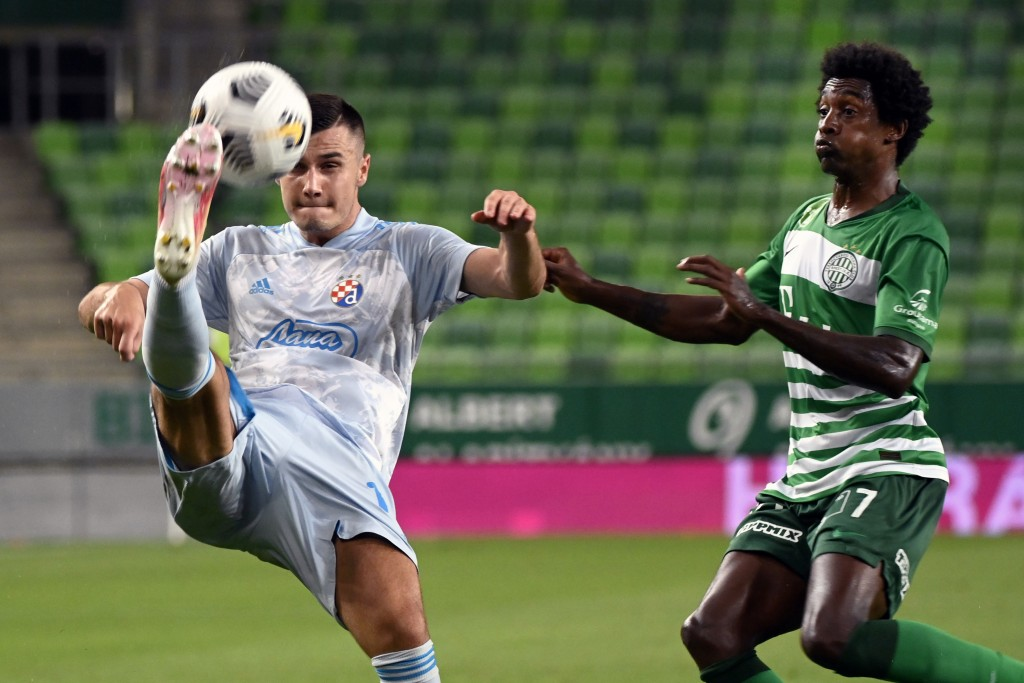 Amer Gojak, left, of Dinamo Zagreb is challenged by Somalia of Ferencvaros for the ball during the Champions' League qualifying third round soccer mat...