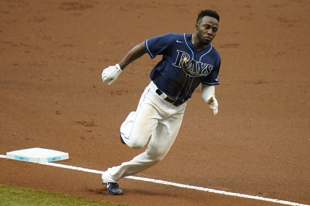 Tampa Bay Rays' Randy Arozarena races home to score on an RBI double by Nate Lowe off Washington Nationals' Austin Voth during the first inning of a b...