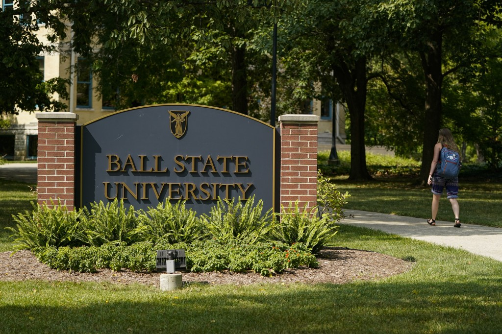 A student enters the campus of Ball State University in Muncie, Ind., Thursday, Sept. 10, 2020. College towns across the U.S. have emerged as coronavi...