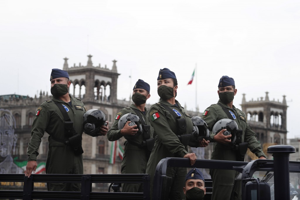 Airforce pilots wearing masks to curb the spread of the new coronavirus participate in the annual Independence Day military parade in Mexico City's ma...