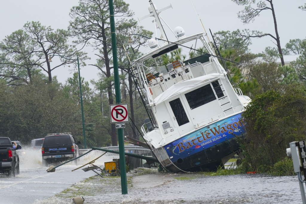 A boat is washed up near a road after Hurricane Sally moved through the area, Wednesday, Sept. 16, 2020, in Orange Beach, Ala. Hurricane Sally made la...