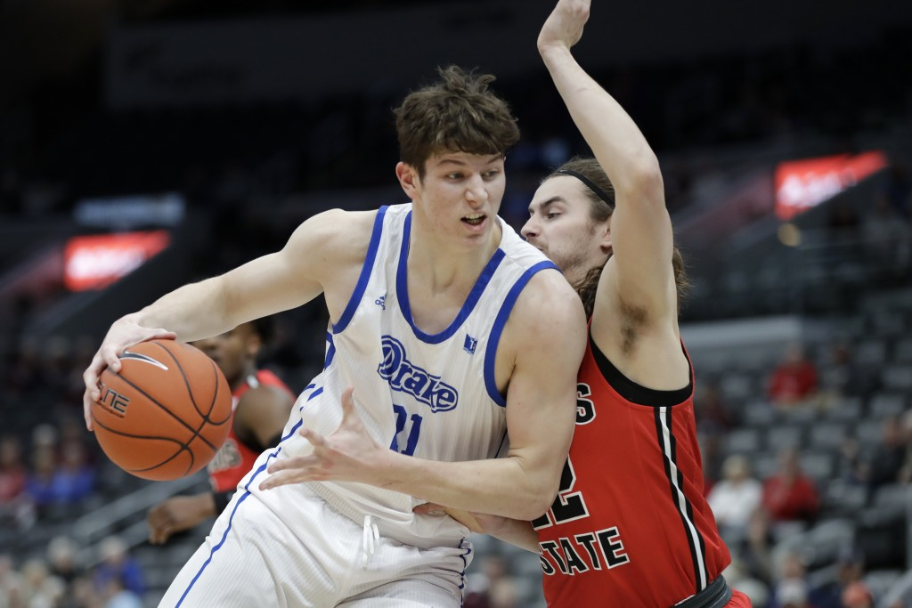 FILE - In this Thursday, March 5, 2020 file photo,Drake's Liam Robbins, left, heads to the basket as Illinois State's Matt Chastain defends during the...