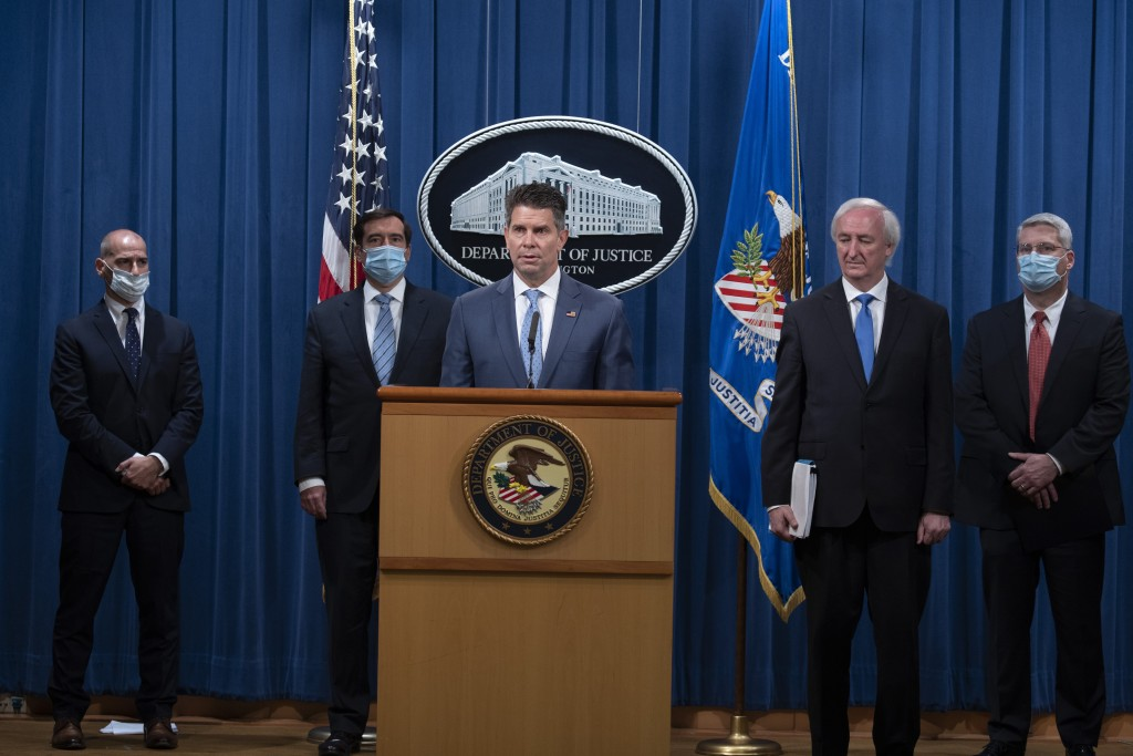 FBI Deputy Director David Bowdich speaks, Wednesday, Sept. 16, 2020 at the Justice Department in Washington. The Justice Department has charged five C...