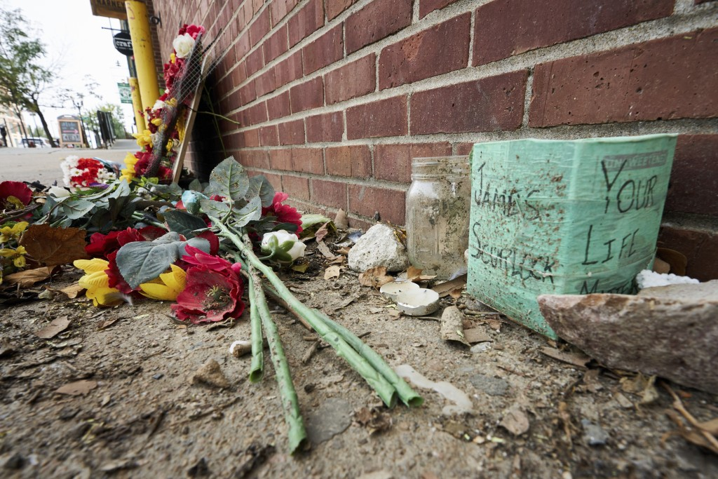 A memorial for James Scurlock remains Wednesday, Sept. 16, 2020, near where he was shot and killed on May 30, in Omaha, Neb. This week's decision to c...