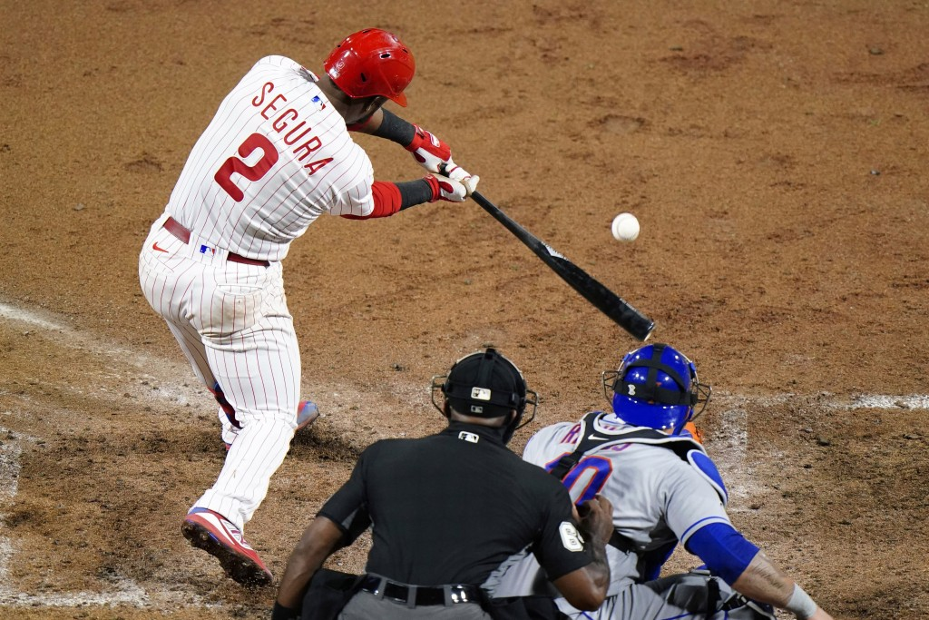 Philadelphia Phillies' Jean Segura hits a single off New York Mets pitcher Michael Wacha during the fifth inning of a baseball game, Wednesday, Sept. ...