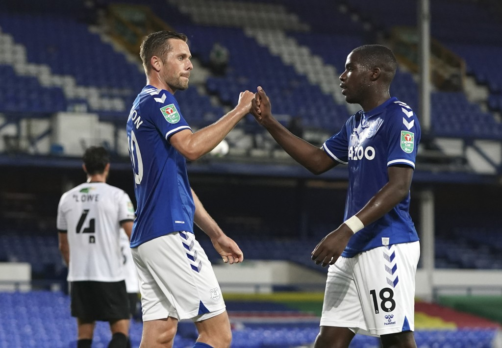 Everton's Gylfi Sigurdsson, left, celebrates after scoring the second goal during the English League Cup soccer match between Everton and Salford City...