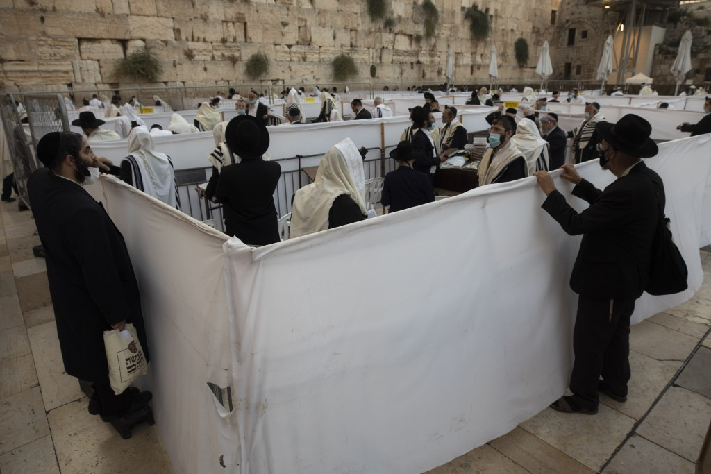 Ultra-Orthodox Jewish men pray ahead of the Jewish new year at the Western Wall, the holiest site where Jews can pray in Jerusalem's old city, Wednesd...