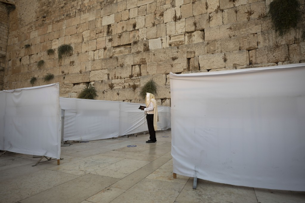 An ultra-Orthodox Jewish man prays ahead of the Jewish new year at the Western Wall, the holiest site where Jews can pray in Jerusalem's old city, Wed...