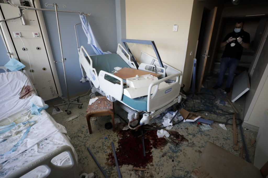 FILE - In this August 5, 2020 file photo, a hospital room is damaged from a massive explosion on Aug. 4, in Beirut, Lebanon. The health services and f...
