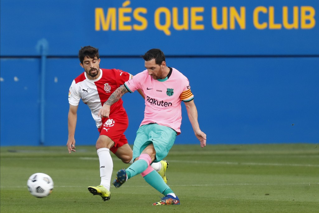 Barcelona's Lionel Messi, right, vies for the ball with Girona's Jairo Izquierdo during the pre-season friendly soccer match between Barcelona and Gir...