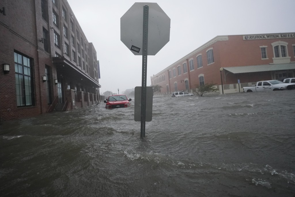 Floodwaters move on the street, Wednesday, Sept. 16, 2020, in Pensacola, Fla. Hurricane Sally made landfall Wednesday near Gulf Shores, Alabama, as a ...