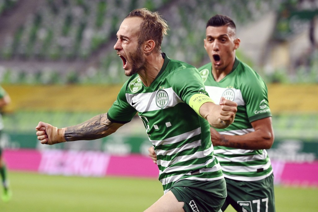 Gergo Lovrencsics of Ferencvaros celebrates after scoring during the Champions' League qualifying third round soccer match between Ferencvaros and Din...
