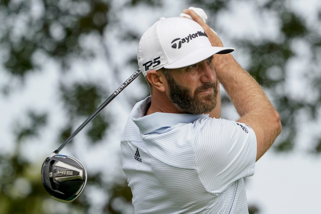 Dustin Johnson, of the United States, tees off the ninth hole during a practice round for the US Open Golf Championship, Wednesday, Sept. 16, 2020, in...