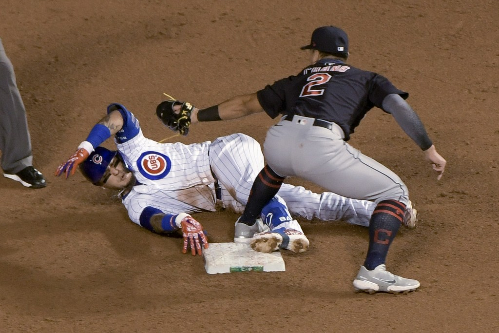 Chicago Cubs' Javier Baez (9) is tagged out by Cleveland Indians second baseman Yu Chang (2) during the second inning of a baseball game Wednesday, Se...