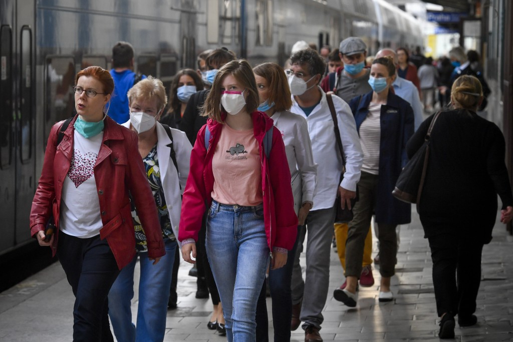People wearing face masks arrive the Masaryk train station in Prague, Czech Republic, Thursday, Sept. 17, 2020 The number of new confirmed coronavirus...