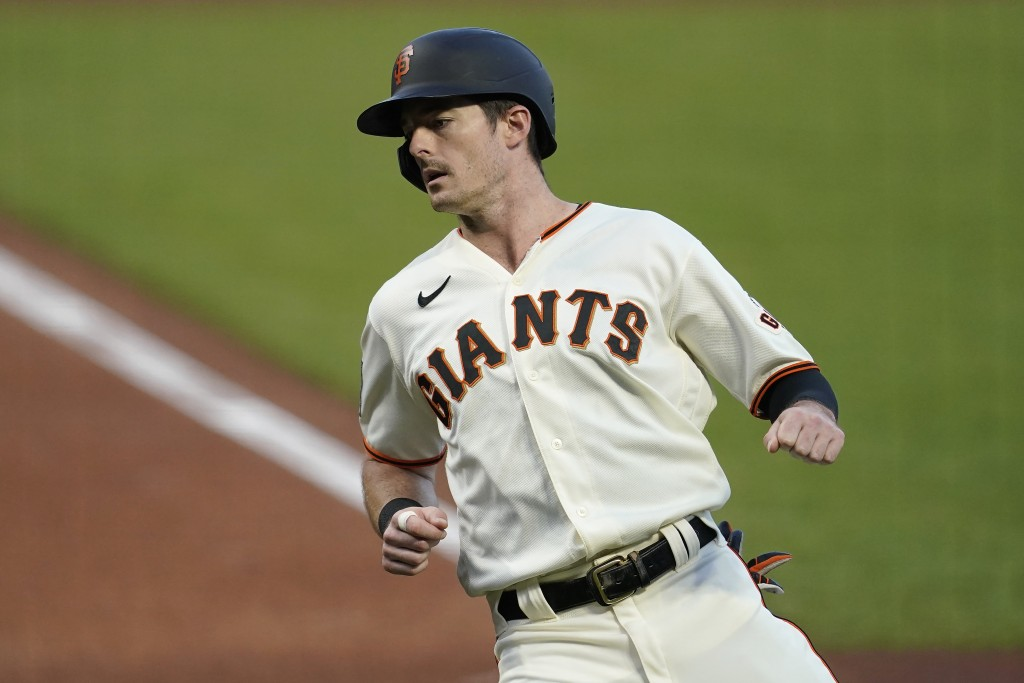 San Francisco Giants' Mike Yastrzemski scores against the Seattle Mariners during the first inning of a baseball game in San Francisco, Wednesday, Sep...