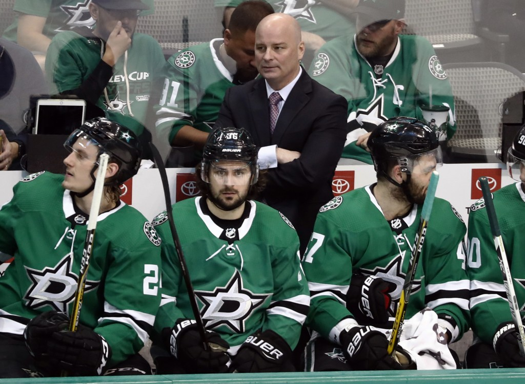 FILE- In this April 17, 2019, file photo, Dallas Stars coach Jim Montgomery, center rear, watches play against the Nashville Predators during the thir...