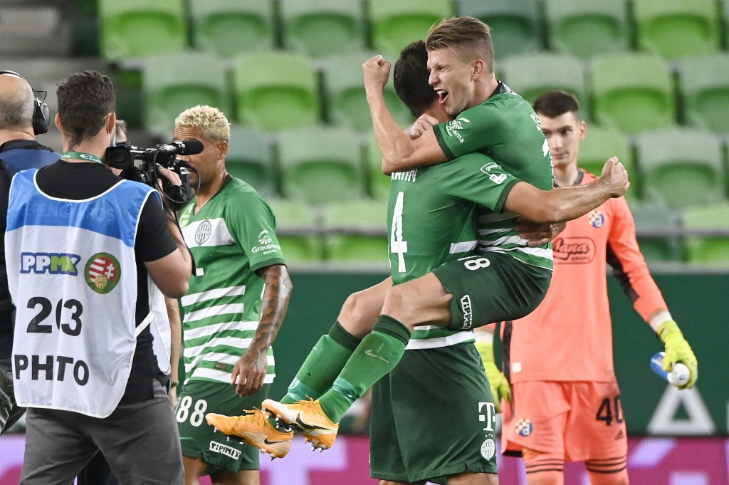 David Siger, right, and Ihor Kharatin of Ferencvaros celebrate their win against Dinamo Zagreb after the Champions' League qualifying third round socc...