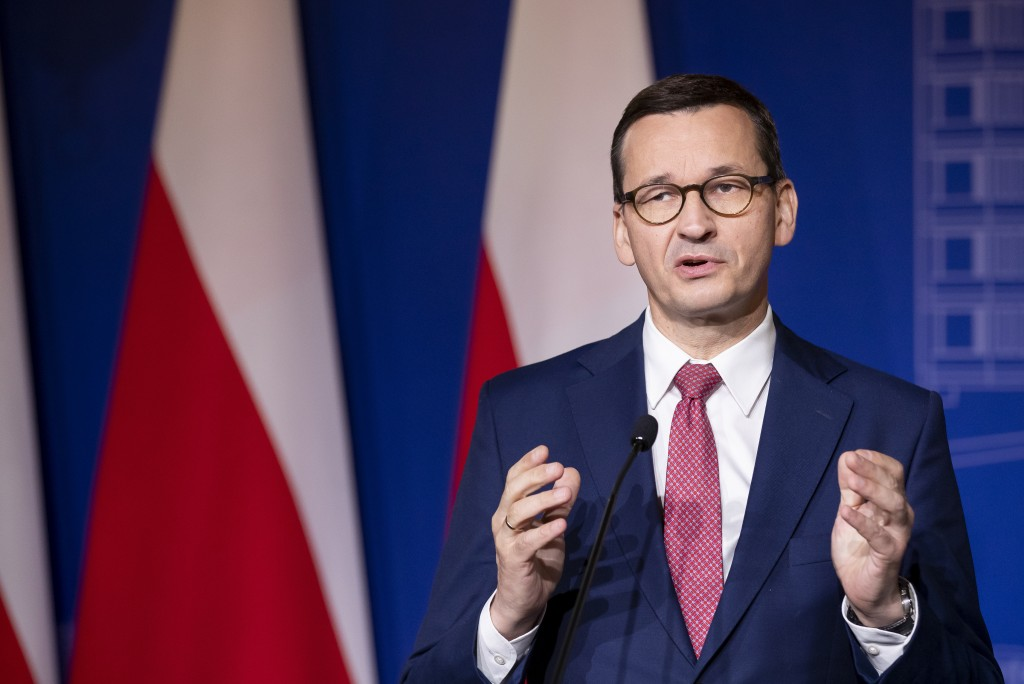 Poland's Prime Minister Mateusz Morawiecki speaks during a news conference following joint meetings of the government of the Lithuania and the governm...