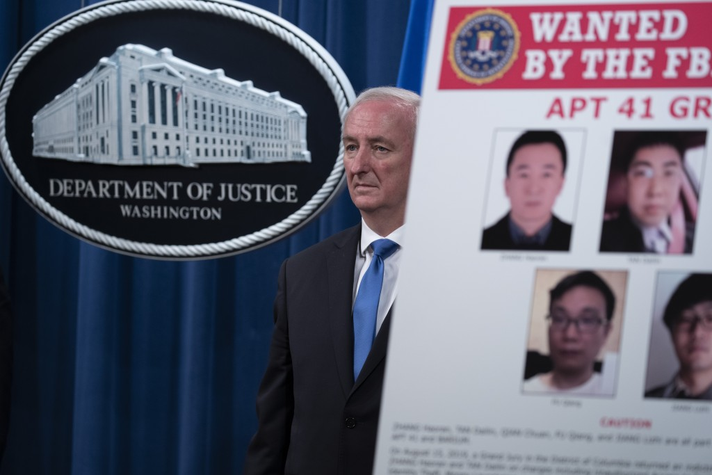 Deputy Attorney General Jeffery Rosen listens, Wednesday, Sept. 16, 2020 at the Justice Department in Washington. The Justice Department has charged f...