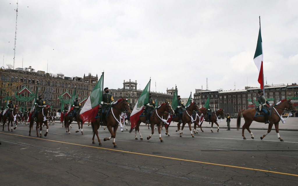 Mounted troops participate in the annual Independence Day military parade in Mexico City's main square of the capital, the Zócalo, Wednesday, Sept. 16...