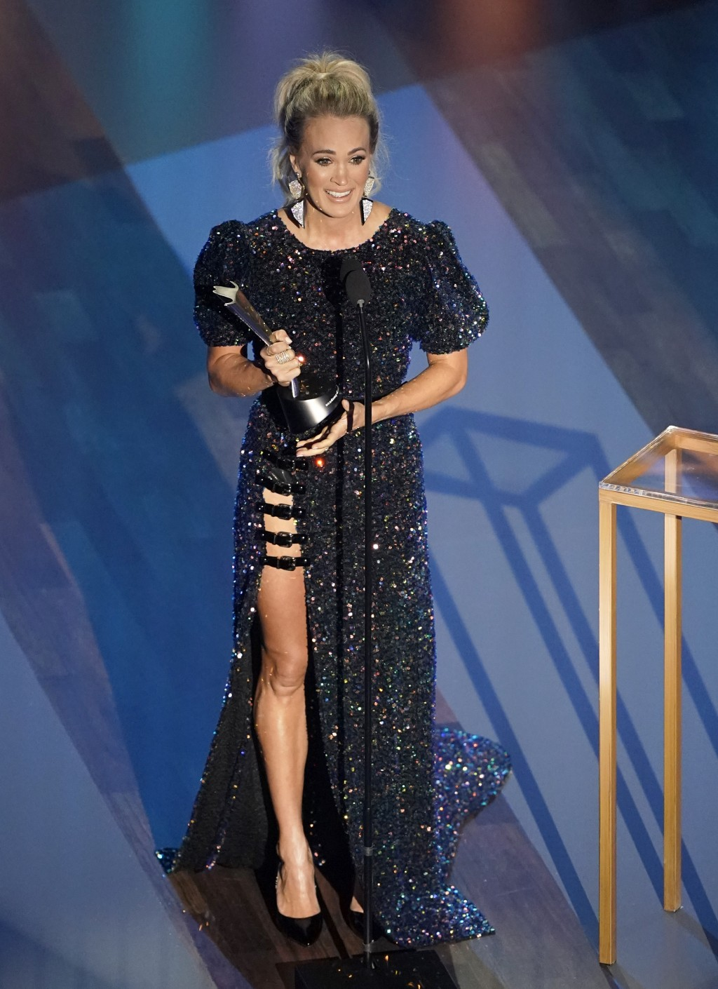 Carrie Underwood accepts the entertainer of the year award in a tie with Thomas Rhett during the 55th annual Academy of Country Music Awards at the Gr...