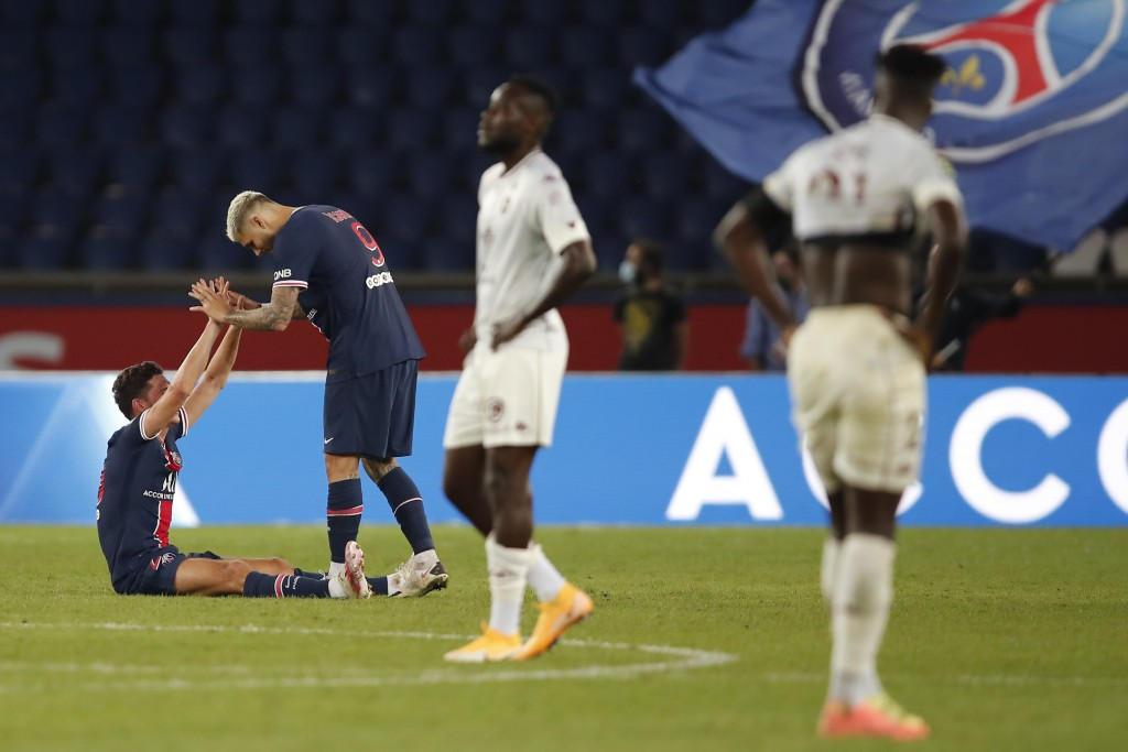 PSG's Julian Draxler , left, celebrates with his teammate PSG's Mauro Icardi end of the French League One soccer match between Paris Saint-Germain and...