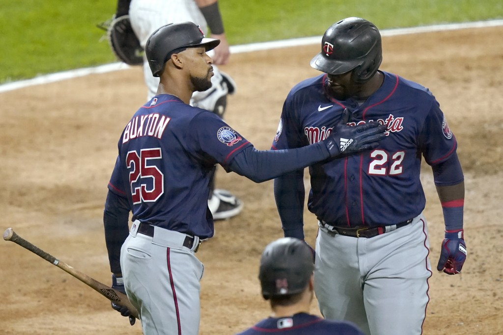 Minnesota Twins' Byron Buxton (25) greets Miguel Sano at home after Sano's two-run home run off Chicago White Sox relief pitcher Matt Foster during th...