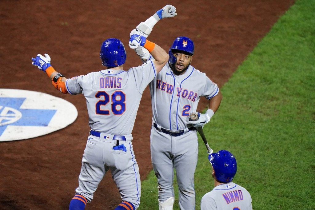 New York Mets' J.D. Davis (28) and Dominic Smith (2) celebrate after Davis' two-run home run off Philadelphia Phillies pitcher Zack Wheeler during the...