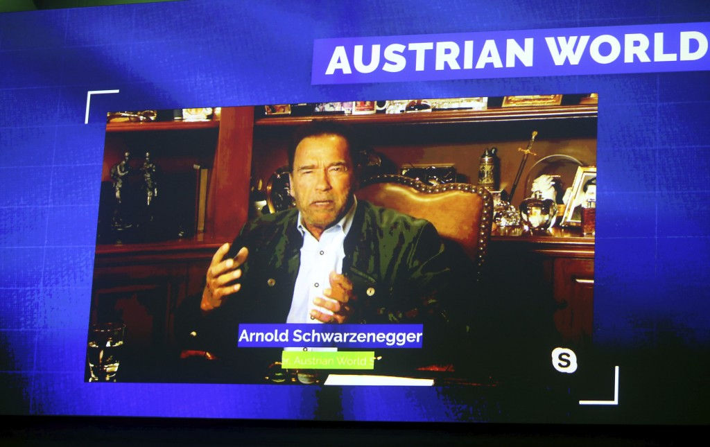 Former California Gov. Arnold Schwarzenegger is seen on a giant video screen during his online broadcasted speech as part of the 'Austrian World Summi...