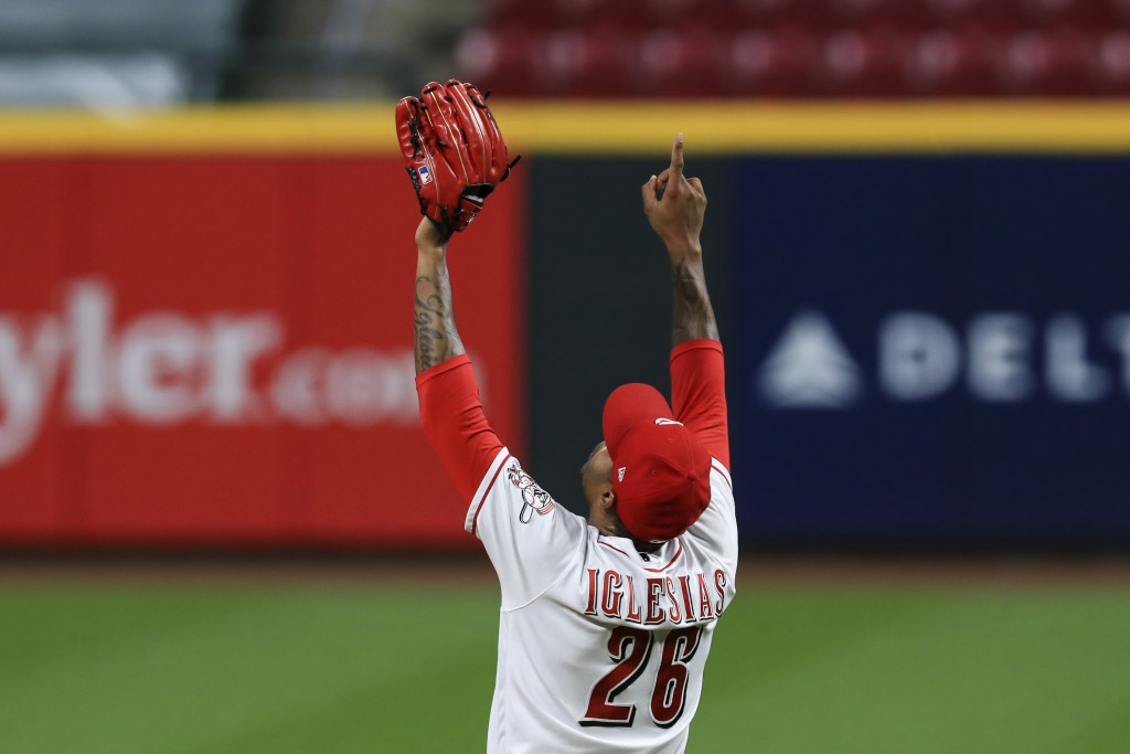 Cincinnati Reds' Raisel Iglesias reacts to the final out in the team's baseball game against the Pittsburgh Pirates in Cincinnati, Wednesday, Sept. 16...