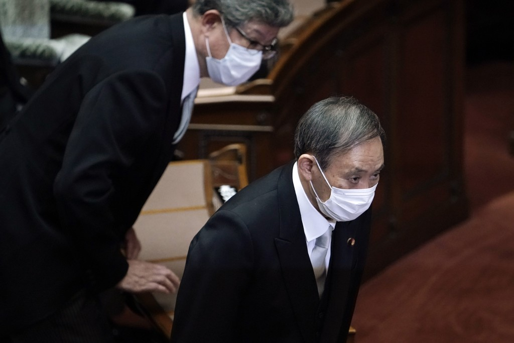 Japan's new Prime Minister Yoshihide Suga attends an extraordinary session at the upper house of parliament Thursday, Sept. 17, 2020, in Tokyo. Suga s...