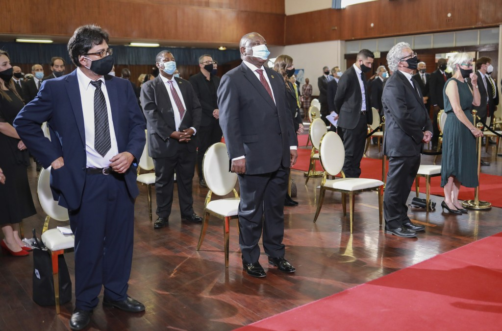 South African President Cyril Ramaphosa, centre, attend the official funeral service of George Bizos, at the Hellenic Cultural Centre in Johannesburg,...