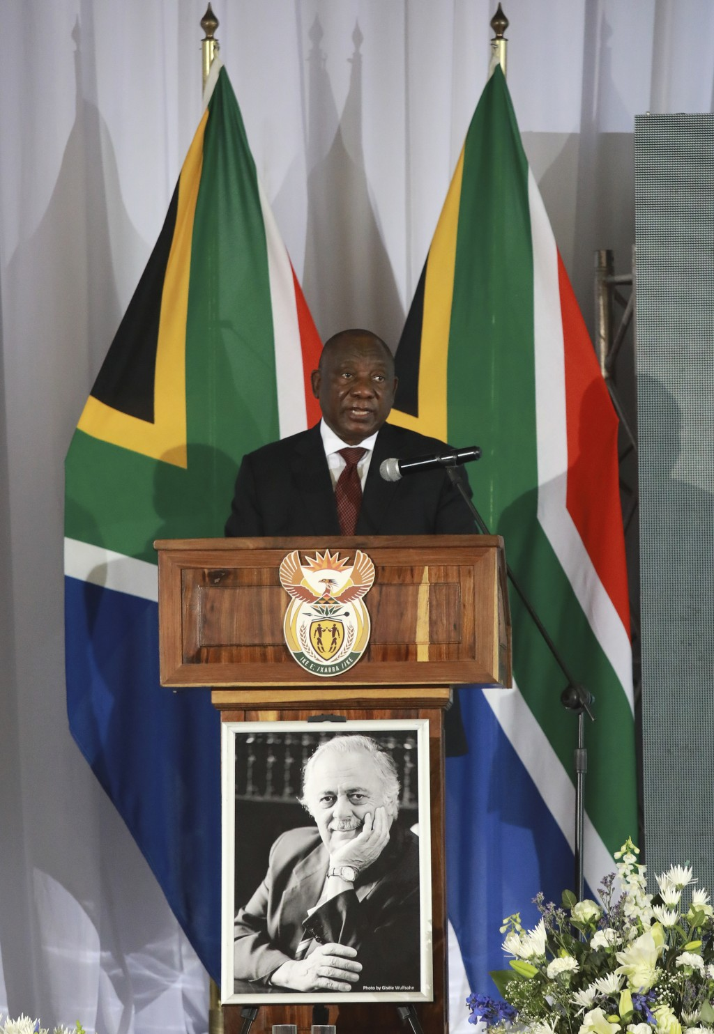 South African President Cyril delivers the eulogy at his official funeral service for George Bizos, portrait foreground, at the Hellenic Cultural Cent...