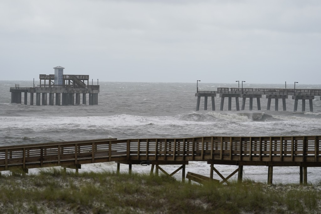 Waves move near a damaged pier at Gulf State Park after Hurricane Sally moved through, Wednesday, Sept. 16, 2020, in Gulf Shores, Ala. The hurricane m...