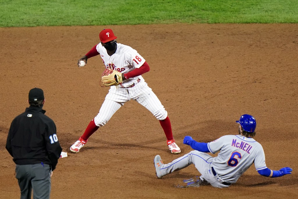 Philadelphia Phillies shortstop Didi Gregorius, center, forces out New York Mets' Jeff McNeil at second on a fielder's choice by Andres Gimenez during...