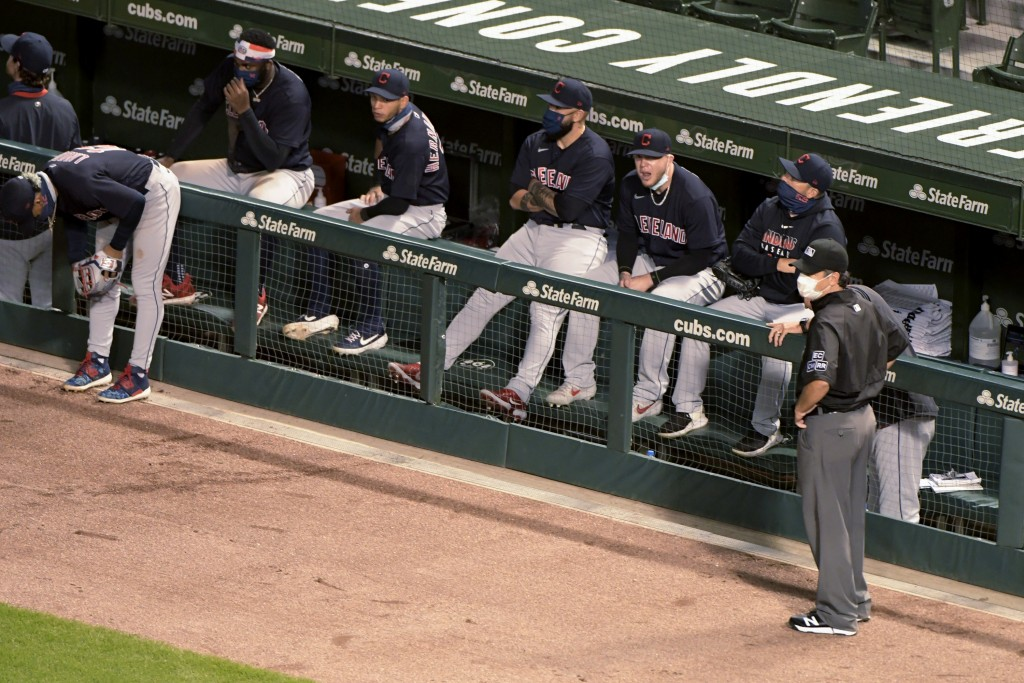 Cleveland Indians wait out a brief suspension of play during the fifth inning after a drone landed in center field, before taking off and flying out o...