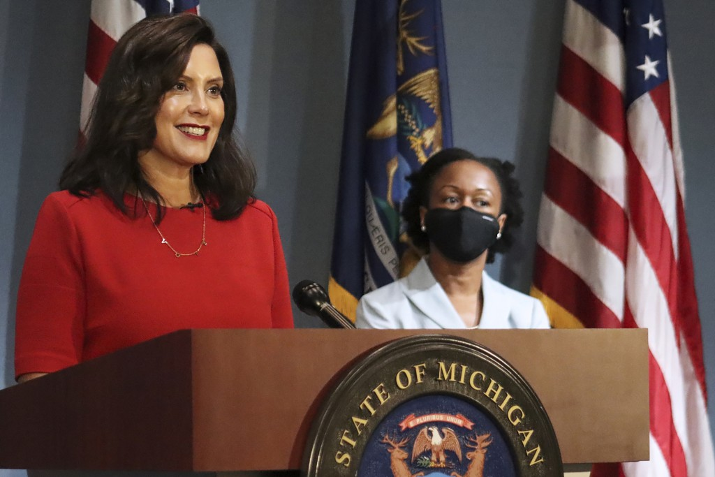 In this photo provided by the Michigan Office of the Governor, Gov. Gretchen Whitmer addresses the state during a speech in Lansing, Mich., Wednesday,...