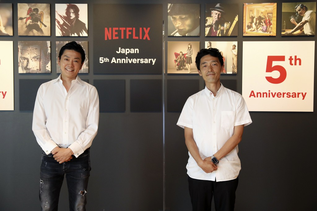 In this photo released by Netflix, Kaata Sakamoto, left, director of its content acquisition, and filmmaker Shinsuke Sato attend a livestream held fro...